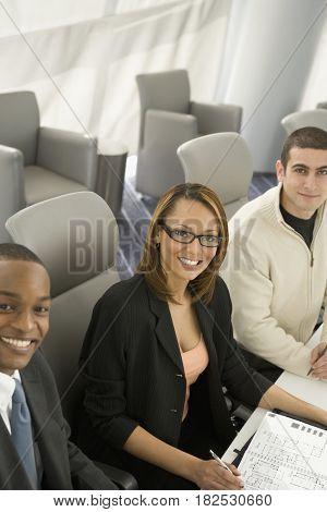 Multi-ethnic business people posing in meeting