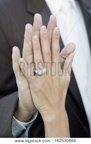 Close up of Hispanic newlyweds' hands