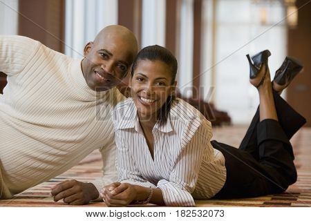 African couple laying on floor