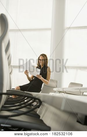 African businesswoman reviewing paperwork in conference room