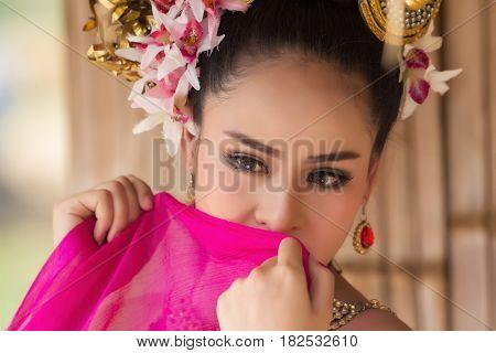 Close up beautiful thai woman face wear thai dress
