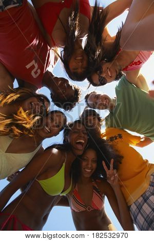 Multi-ethnic group of friends hugging