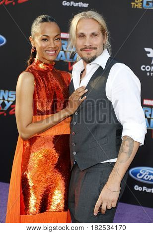 Marco Perego and Zoe Saldana at the Los Angeles premiere of 'Guardians Of The Galaxy Vol. 2' held at the Dolby Theatre in Hollywood, USA on April 19, 2017.