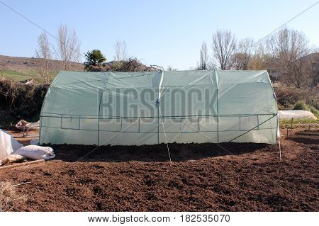 Polythene tunnel as a plastic greenhouse in an allotment, garden center