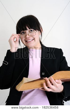 worried female student with old book on white background