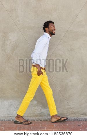 Full Body Handsome African Man Walking And Smiling