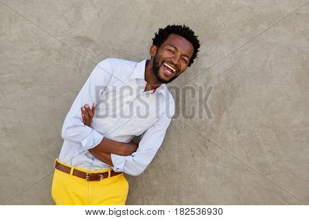 Joyful African American Man Leaning Against Wall