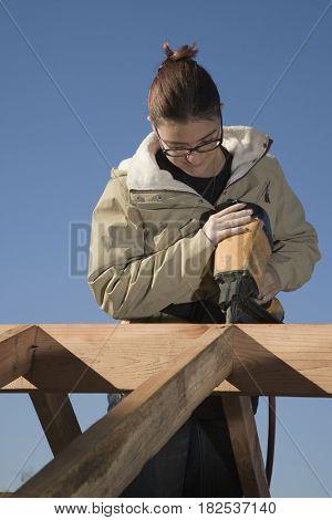 Mixed race woman using nail gain