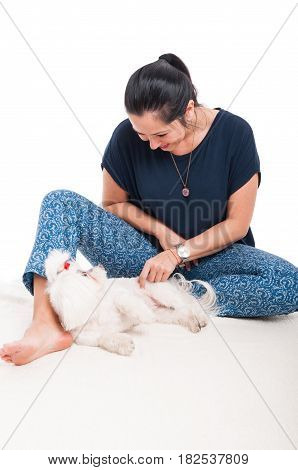 Picture Of Young Female Playing With Her Bichon