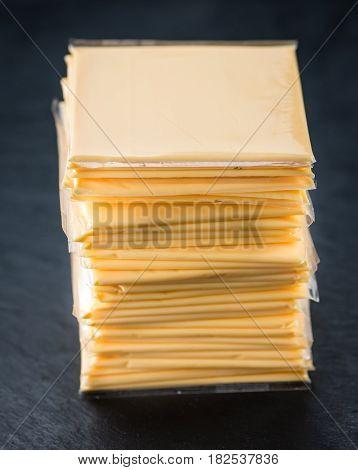 Sliced Cheese On A Slate Slab (selective Focus)