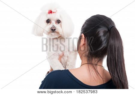 Woman Holding Her Dog On The Shoulder