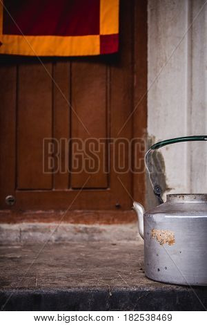 Tea pot used by monks to serve their salty tea with yak butter during prayer service outside the door of the monastery. Ka-Nying Shedrub Ling Monastery Boudhanath district. Kathmandu Nepal.