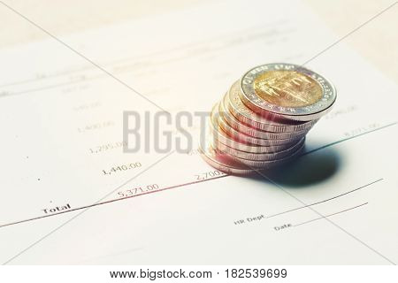 Thai Baht Coin On Paperwork Summary Report With Savings Concept.