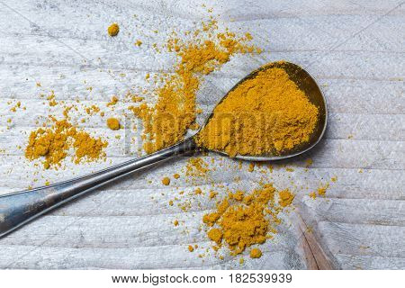 Curry powder on a spoon macro detail