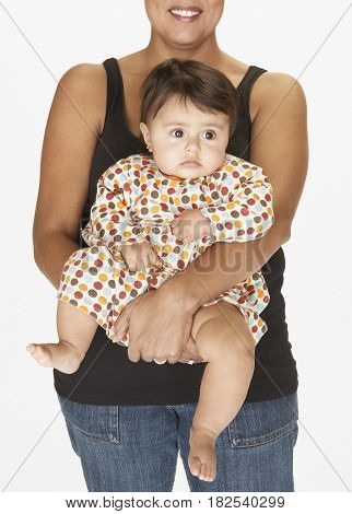 Hispanic mother holding baby daughter