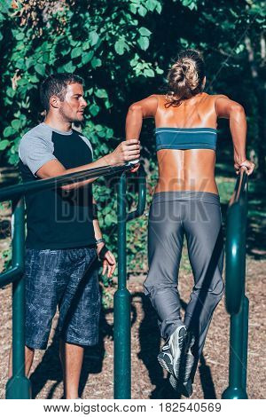 Parallel bar dip exercise on training outdoors