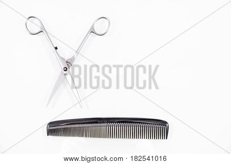 Hair cutting shears and comb isolated on white background