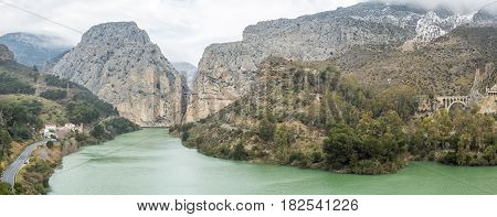 Panorama of Caminito del Rey. Lake with green water placed in the hills. El Chorro Malaga Spain