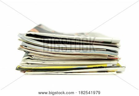 Pile of newspapers and magazines on white background