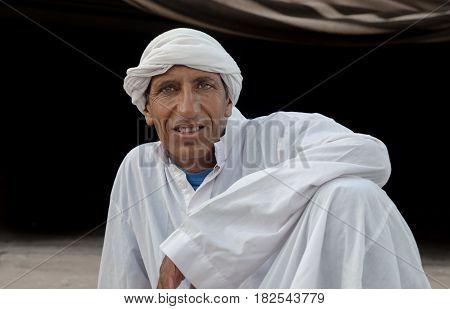 ISRAEL. NEGEV DESERT - SEPTEMBER 12, 2014: A traditional dressed Bedouin at Negev desert. Israel