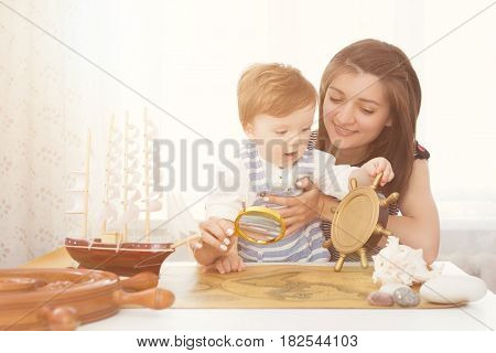 Mom And Child Making Model Ship. Concept Of Sea, Adventures And Travel