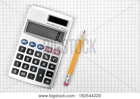 Calculator and lead pencil on squared paper
