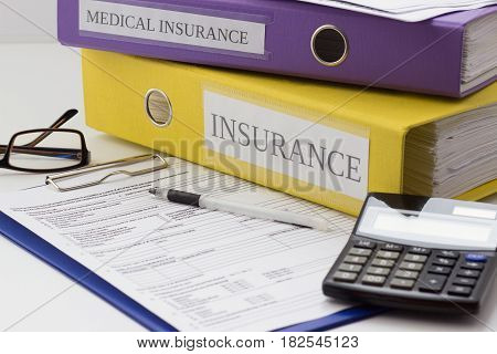 Clean Insurance Form, Folders, Pen, Glasses And Calculator