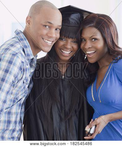 African friends congratulating graduate
