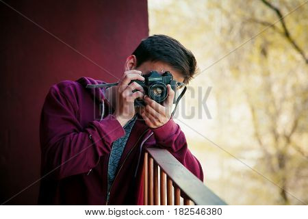Photographer take shot in his vintage style camera