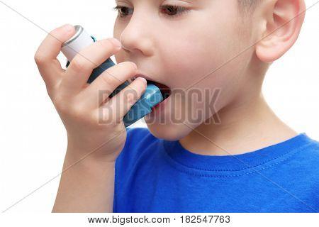 Little boy using asthma inhaler, closeup