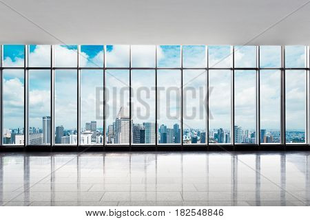 cityscape of modern city from empty office
