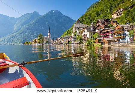 Classic View Of Hallstatt With Traditional Rowing Boat In Summer, Salzkammergut Region, Austria