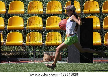 Unidentified Girl Runs With Ball