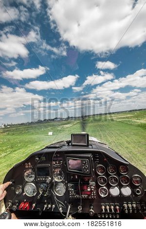 View from the pilot's seat in the cockpit of a light plane while landing