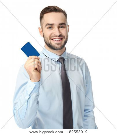 Handsome young man with business card on white background