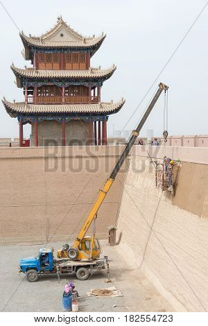 Jiayuguan, China - Apr 13 2015: Restoration Is Under Work In Jiayuguan Pass, West End Of Great Wall.