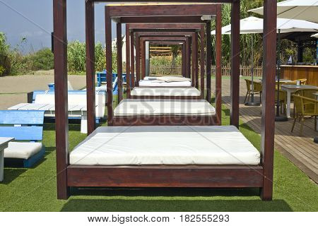 Lounger beds on beach relaxing resort south of Spain