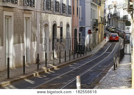 Lisbon, Portugal, April 8, 2017 : A Street Of Bairro Alto With Tramway Rails.