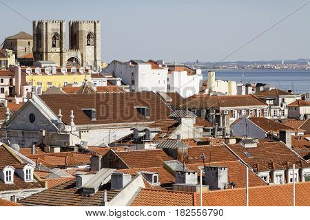 Lisbon, Portugal, April 5, 2017 : Roofs Of Lisbon And Se Cathedral, With Tagus River In The Backgrou