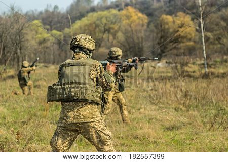 Front Line. Military attack on battlefield with kalashnikov