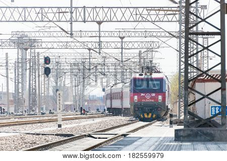 Gansu, China - Apr 12 2015: China Railways Hxd3D Electric Locomotive In Zhangye Railway Station, Gan