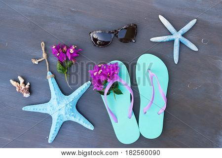 Summer beach fun - sandals with sunglasses and starfish