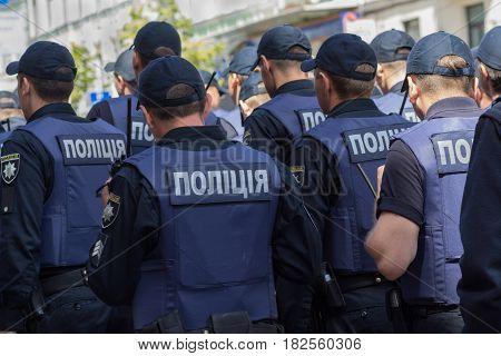 Kiev Ukraine - June 12 2016: Rows of Ukrainian policemen protecting participants out gay parade