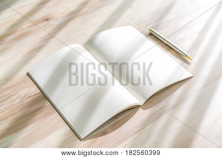 Blank catalog, magazines,book mock up with pen on wood background.