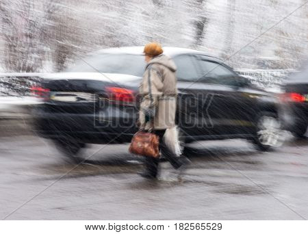 Woman On Zebra Crossing In A Rainy Day
