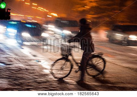 Dangerous City Traffic Situation With Cyclist And Car In The City At Night
