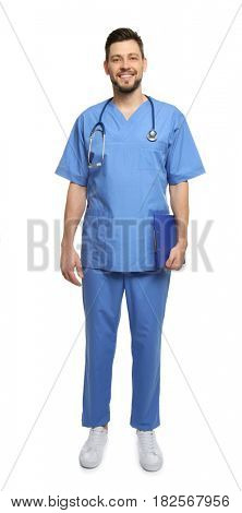 Handsome surgeon standing on white background