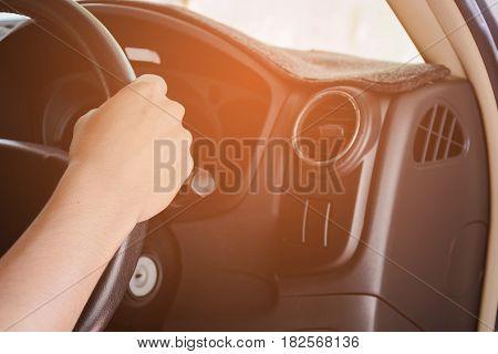 man drive a car alone at evening