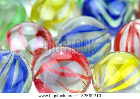 Colorful glass marbles close up image .