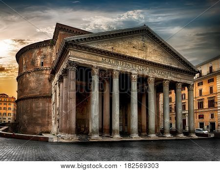 Ancient Pantheon and cloudy sky at sunrise in Rome, Italy